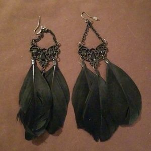 Black feather earrings never worn